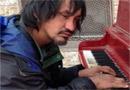 Man on the Street Plays Beautifully